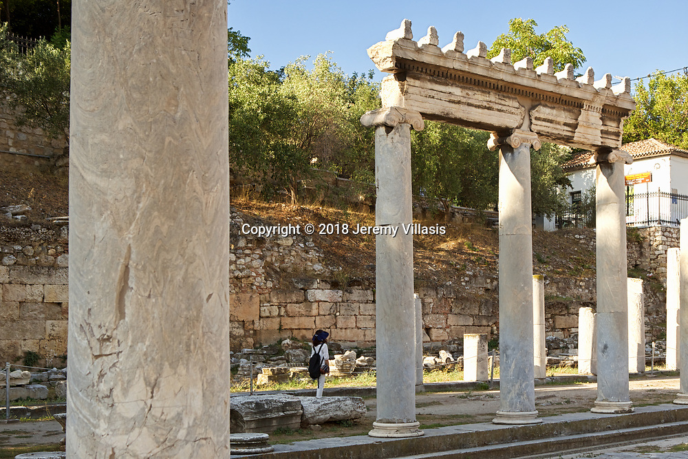 The East Propylon served as the east entrance to the Roman Agora in Athens, Greece. Ionic columns made of gray Hymettian marble make up the East Propylon. Built in the first century BC, the Roman Agora served as the new commercial center of Athens when it became part of the Roman Empire.