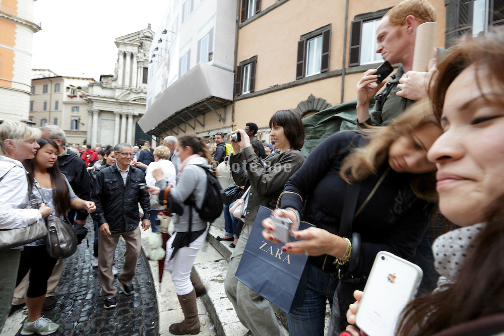 tourists crowd photographing at Trevi fountain Rome Italy