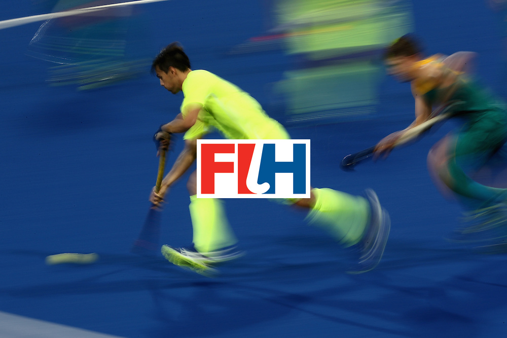 RIO DE JANEIRO, BRAZIL - AUGUST 12:  Adam Imer #6 of Brazil runs upfield against Australia during a Men's Preliminary Pool B match on Day 7 of the Rio 2016 Olympic Games at the Olympic Hockey Centre on August 12, 2016 in Rio de Janeiro, Brazil.  (Photo by Sean M. Haffey/Getty Images)