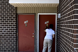 Tanzie Youngblood knocks  doors in an attempt to pursue residents at a low-income housing project to vote in the upcoming Primaries.