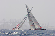 Alinghi SUI100 crosses ahead of Emirates Team New Zealand NZL92 in the first beat. The first race of the 32nd America`s Cup. 23/6/2007