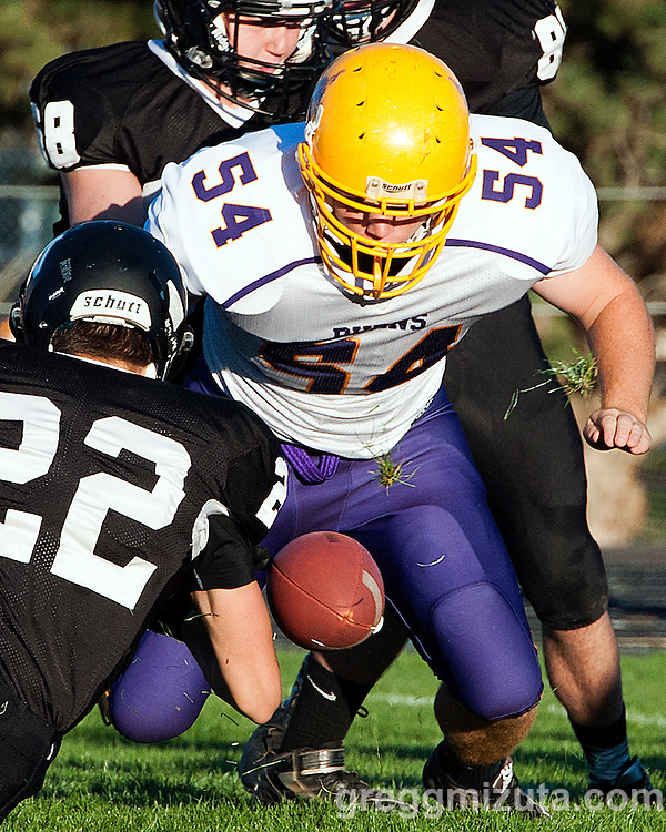 Vale's Jacob Delong and Burns's Ty Ried scramble to recover a fumble, Vale - Burns football game, September 18, 2015 at Vale High School, Vale, Oregon. Vale won 65-28.