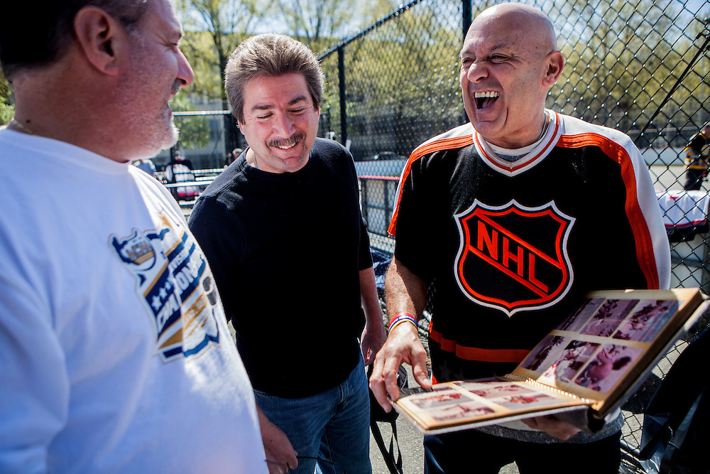 QUEENS, NY - MAY 2, 2015: Paul Manzi, Joe Comparetto and Dave Ovimeleh share memories before an annual reunion of old-time street hockey players in Long Island City. This year's tournament was held in the memory of Craig Allen, who was described as one of the best players of his time and who died unexpectedly last week just days before the tournament. CREDIT: Sam Hodgson for The New York Times