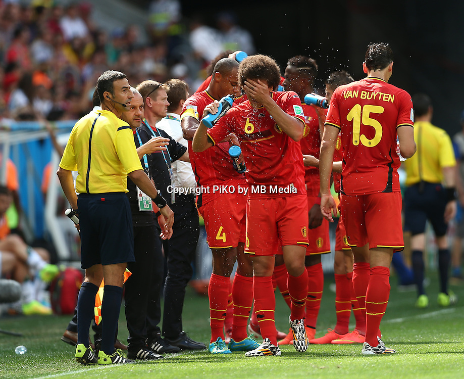 Fifa Soccer World Cup - Brazil 2014 - <br /> ARGENTINA (ARG) Vs. BELGIUM (BEL) - Quarter-finals - Estadio Nacional Brasilia -- Brazil (BRA) - 05 July 2014 <br /> Here Belgian players  Vincent KOMPANY (L) -  Axel WITSEL (C) and Daniel VAN BUYTEN (R) refreshing during the game.<br /> &copy; PikoPress