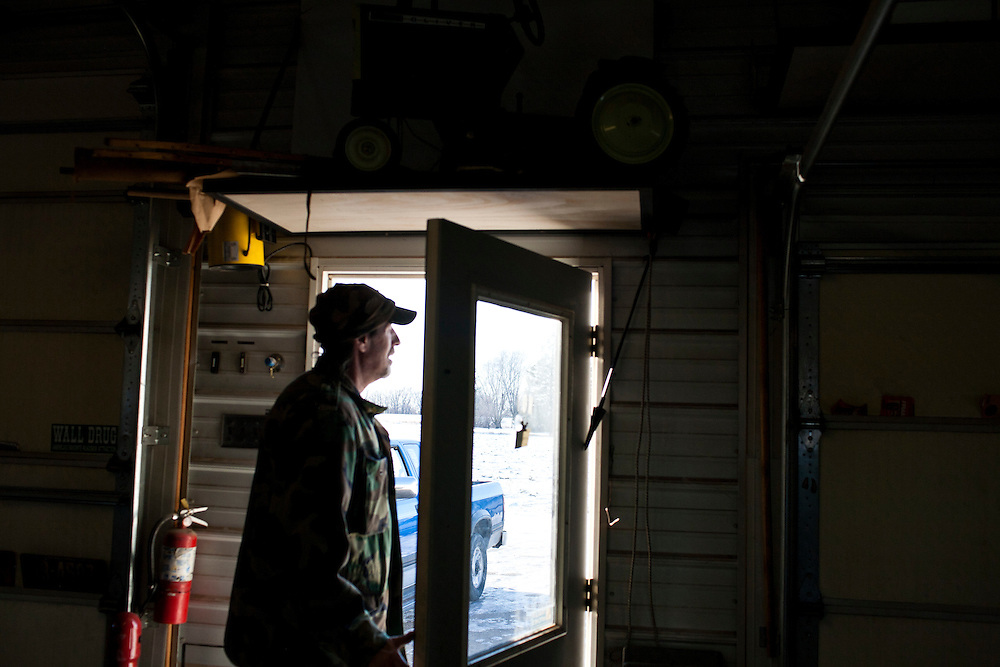 A man leaves Donovan Nokes' shop on Friday, December 9, 2011 in Webster City, IA.