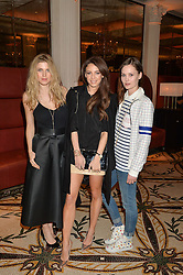 Left to right, ASHLEY JAMES, DANIELLE PEAZER and CHARLOTTE de CARLE at a dinner hosted by Amy Molyneaux and Percy Parker of fashion label PPQ to celebrate the PPQ AW 2015 collection 'Persephone' held at Braserie Chavot, 41 Conduit Street, London on 22nd February 2015.