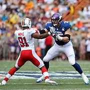 USC All American and Minnesota Viking, Matt Kalil demonstrates his excellent pass protection skills versus Miami Dolphin Cameron Wake at the NFL Pro Bowl 2013, Aloha Stadium, Honolulu, Hawaii. Photo by Barry Markowitz, 1/27/13