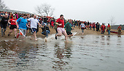 Participants rush into the ice cold water for a good cause at the annual Polar Plunge at Lake Snowdon.