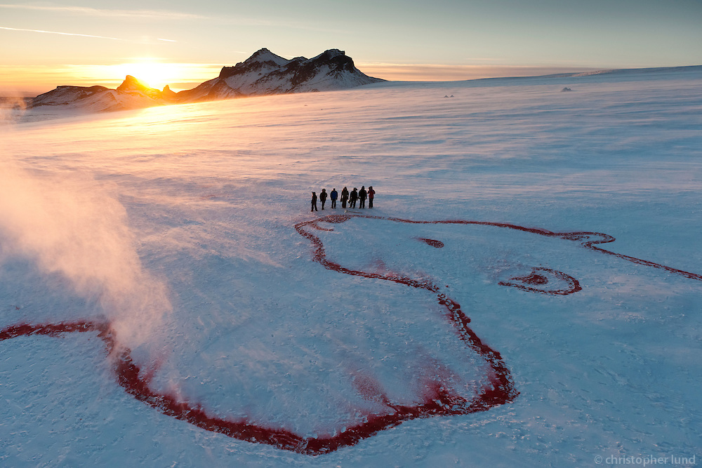 Red Polar Bear by Bjargey Ólafsdóttir. Part of Earth 350.org project. Painted with red organic food dye on Langjökull Glacier, Iceland. Size approx 50x90 meters.