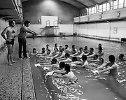 After a spate of accidents at sea where several fishermen drowned, Bord Iascaigh Mhara instituted a programme of swimming lessons for skippers and crews from around the country. Here, instructor Seamus Waters demonstrates the use of the float.<br />