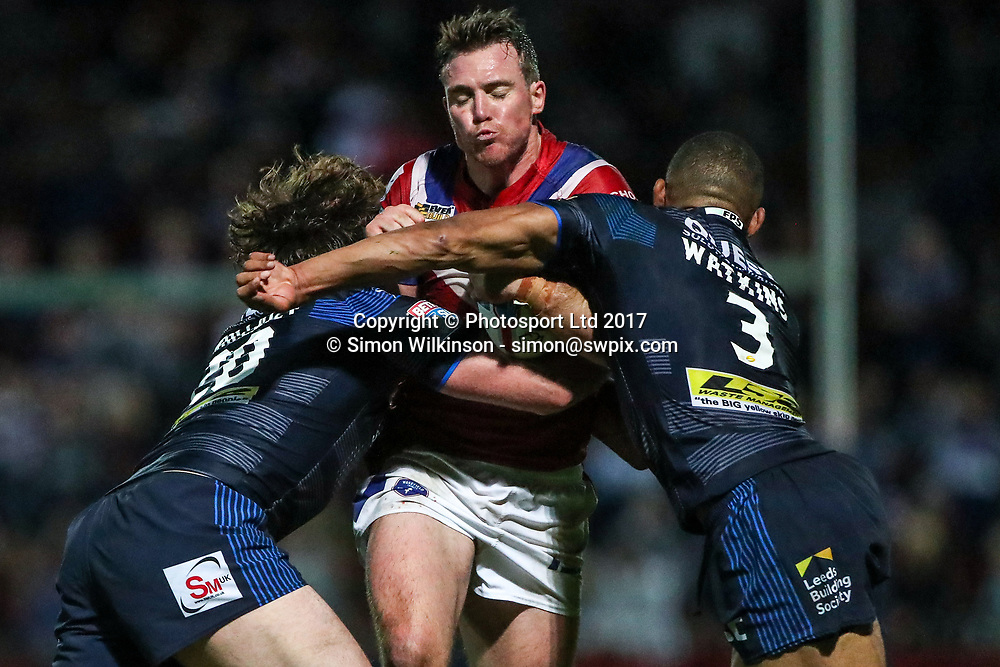 Picture by Alex Whitehead/SWpix.com - 10/08/2017 - Rugby League - Betfred Super League - Wakefield Trinity v Leeds Rhinos - Beaumont Legal Stadium, Wakefield, England - Wakefield's Matty Ashurst is tackled by Leeds' Kallum Watkins and Anthony Mullally.