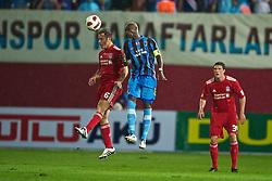 TRABZON, TURKEY - Thursday, August 26, 2010: Liverpool's Fabio Aurelio and Trabzonspor's Ibrahima Yattara during the UEFA Europa League Play-Off 2nd Leg match at the Huseyin Avni Aker Stadium. (Pic by: David Rawcliffe/Propaganda)