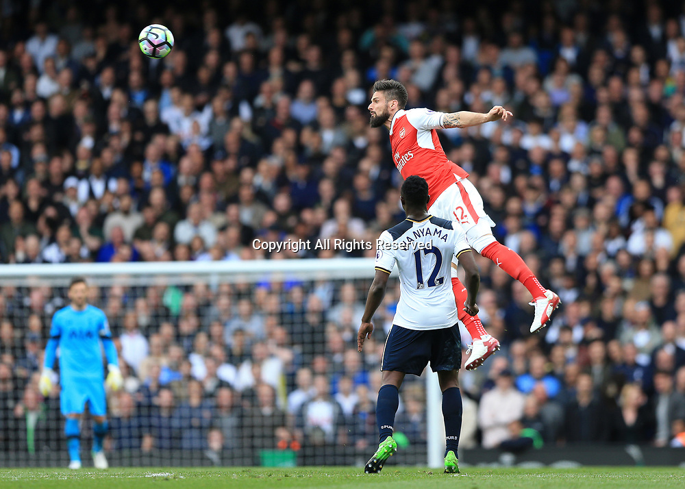 April 30th 2017, White Hart Lane, Tottenham, London England; EPL Premier League football Tottenham Hotspur versus Arsenal; Olivier Giroud of Arsenal leaps over Victor Wanyama of Tottenham Hotspur to head the ball