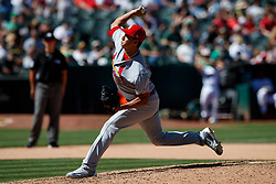 OAKLAND, CA - AUGUST 04:  Giovanny Gallegos #65 of the St. Louis Cardinals pitches against the Oakland Athletics during the seventh inning at the RingCentral Coliseum on August 4, 2019 in Oakland, California. The Oakland Athletics defeated the St. Louis Cardinals 4-2. (Photo by Jason O. Watson/Getty Images) *** Local Caption *** Giovanny Gallegos