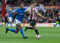 Football - 2016 / 2017 FA Cup - Third Round: Brentford vs. Eastleigh<br /> <br /> Gavin Hoyte of Eastleigh FC concedes the penalty at Griffin Park.<br /> <br /> COLORSPORT/DANIEL BEARHAM