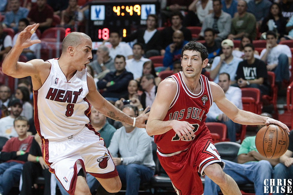 12 March 2010: Chicago Bulls guard Kirk Hinrich drives past Miami Heat guard Carlos Arroyo during the Miami Heat 108-95 victory over the Chicago Bulls at the AmericanAirlines  Arena, in Miami, Florida, USA.
