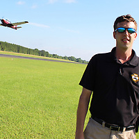Monroe County Airport Manager Wes Kirkpatrick stands beside the runway as a plane takes off for flight. He was recently appointed to the Mississippi Airports Association Board of Directors. The association  promotes the interests of the state's 72 airports and aviation.