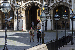Parliament, May 24th 2017. Police and army servicemen patrol the grounds of Parliament following the raising of the terror threat level to Critical by the COBRA committee.
