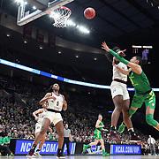March 31, 2019; Portland, OR, USA;  Oregon Ducks forward Satou Sabally (0) shoots over Mississippi State Bulldogs center Teaira McCowan (15) in the Elite Eight of the NCAA Women's Tournament at Moda Center.<br /> Photo by Jaime Valdez
