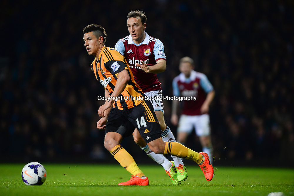 26 March 2014 - Barclays Premier League - West Ham United v Hull City - Jake Livermore of Hull City in action with Mark Noble of West Ham United - Photo: Marc Atkins / Offside.