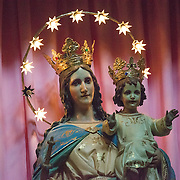 The Madonna and Child statue, ringed by lights, that forms the centerpiece of the altar at the the Iglesia de Santa Ines (Church of Saint Agnes) in the historic Centro Historico district of downtown Mexico City, Mexico.