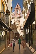 Staromiejska uliczka z kosciolem w tle.Sevilla 08.2007.fot Piotr Gesicki Sevilla Spain Andalucia narrow streets of old town photo Piotr Gesicki