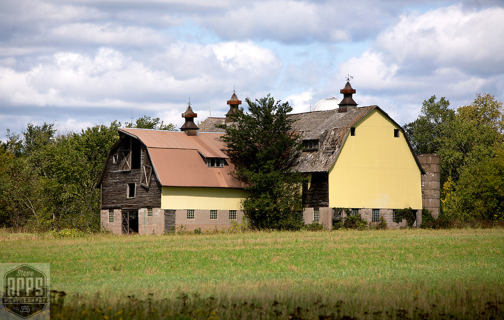 A collection of Barns that still can be seen while traveling the countryside in  the beautiful State of Wisconsin.<br /> Washburn County- L-shaped barn on County B north of 53 1/2 mile North of Sarona. Barns from around the State of Wisconsin.