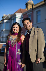 Image ©Licensed to i-Images Picture Agency. 07/03/2015. London, United Kingdom. Ravi Bhanot and family, Conservative Party supporters in Ilford. Ravi and his wife Sushma pose together outise his sister house in  Ilford. Picture by Daniel Leal-Olivas / i-Images