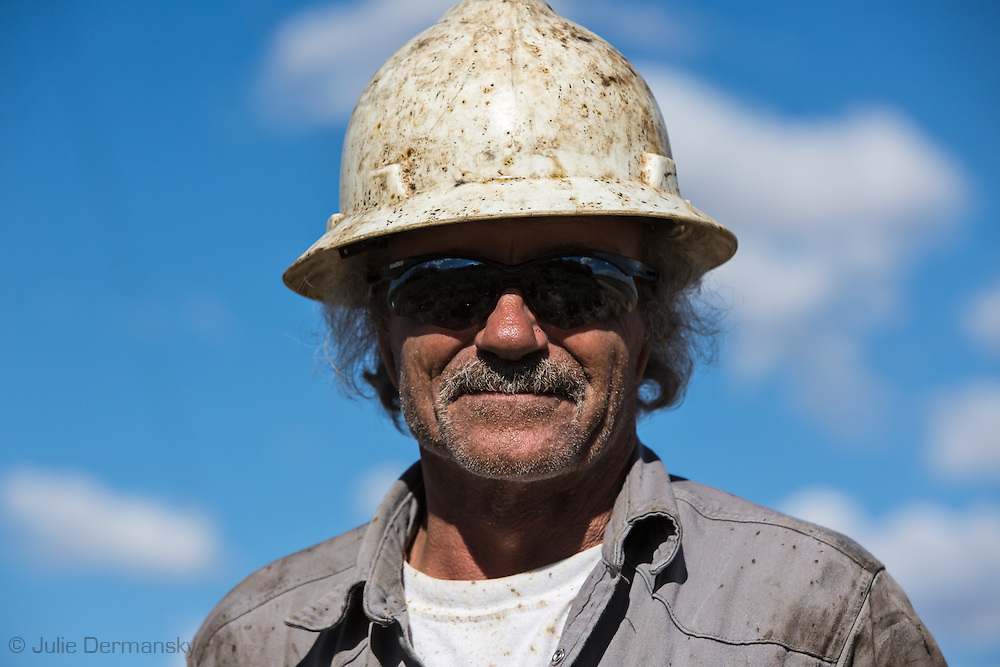 Oil field worker on a site on federal land in the San Juan Basin in Northwestern New Mexico where fracking is booming.