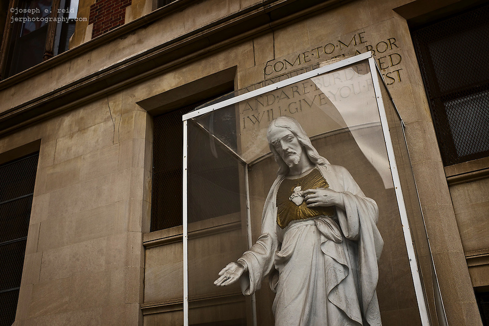 Statue of Jesus in transparant box outside chruch, New York, NY, US