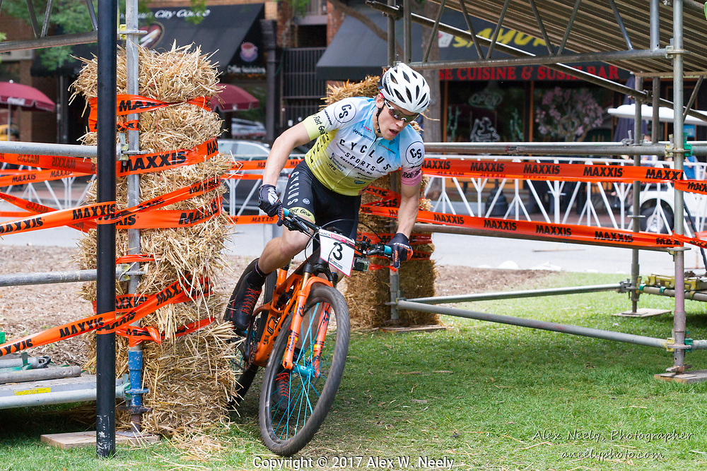 Seth Kemp (USA) negotiates the turns under the bridge on his way to a 3rd place finish in the finals of the UCI Mountain Bike Eliminator World Cup held in  Columbus, GA ,USA on June 4, 2017.
