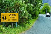 Caution Children sign in Gaelic in Gaelticht area of Connemara, County Galway, Ireland
