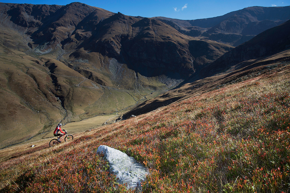 Mountain biker riding the slopes of the Tarcu Mountains Natura 2000 site. Southern Carpathians, Munții Ṭarcu, Caraș-Severin, Romania.