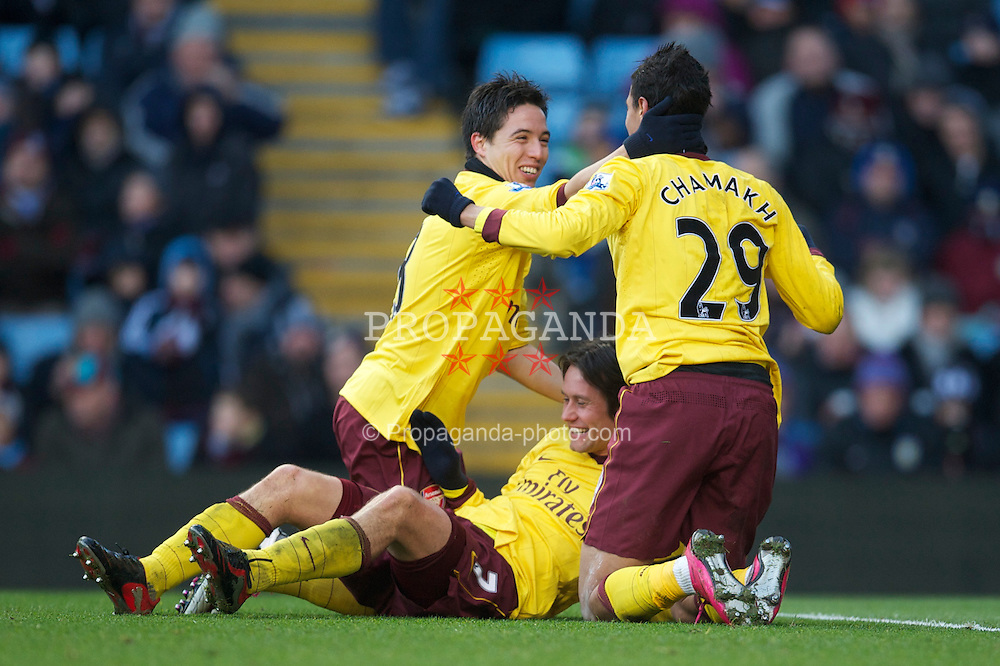 BIRMINGHAM, ENGLAND - Saturday, November 27, 2010: Arsenal's Marouane Chamakh celebrates scoring the third goal against Aston Villa with team-mates Samir Nasri and Tomas Rosicky during the Premiership match at Villa Park. (Pic by: David Rawcliffe/Propaganda)