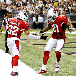Sep 22, 2013; New Orleans, LA, USA; Arizona Cardinals defensive back Tyrann Mathieu (32) and cornerback Patrick Peterson (21) celebrate following an interception against the New Orleans Saints during a game at Mercedes-Benz Superdome. The Saints defeated the Cardinals 31-7. Mandatory Credit: Derick E. Hingle-USA TODAY Sports