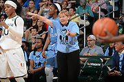 January 3, 2015: Head coach Sylvia Hatchell of North Carolina wears a t-shirt featuring a tribute to former North Carolina coach Dean Smith during the NCAA basketball game between the Miami Hurricanes and the North Carolina Tar Heels in Coral Gables, Florida. The Tar Heels defeated the 'Canes 66-65.