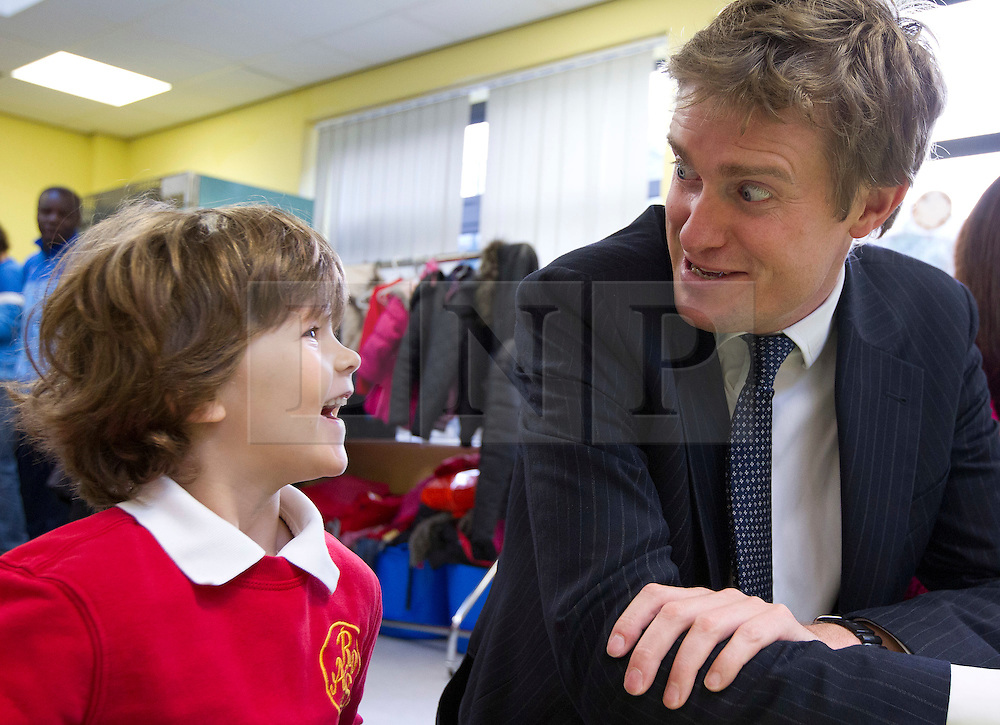 © Licensed to London News Pictures. 09/10/2013. London, UK. Tristram Hunt, Labour's Shadow Secretary of State for Education, interacts with pupils during a visit with Rachel Reeves (the Shadow Work and Pensions Secretary) to a children's breakfast club at Richard Atkins Primary School in Brixton, London, today (09/10/2013). The visit marks the first for the two politicians who were appointed to their shadow cabinet positions on Monday this week (14/10/13). Photo credit: Matt Cetti-Roberts/LNP