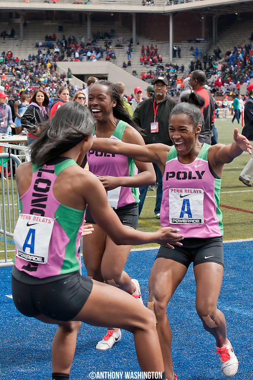 Athletes from Long Beach Poly High School (California) celebrate after winning the High School Girls' 4x100 Championship of America at the Penn Relays athletic meets on Friday, April 27, 2012 in Philadelphia, PA.