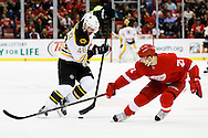 Apr 2, 2015; Detroit, MI, USA; Boston Bruins center David Krejci (46) and Detroit Red Wings left wing Tomas Tatar (21) battle for the puck in the second period at Joe Louis Arena. Mandatory Credit: Rick Osentoski-USA TODAY Sports