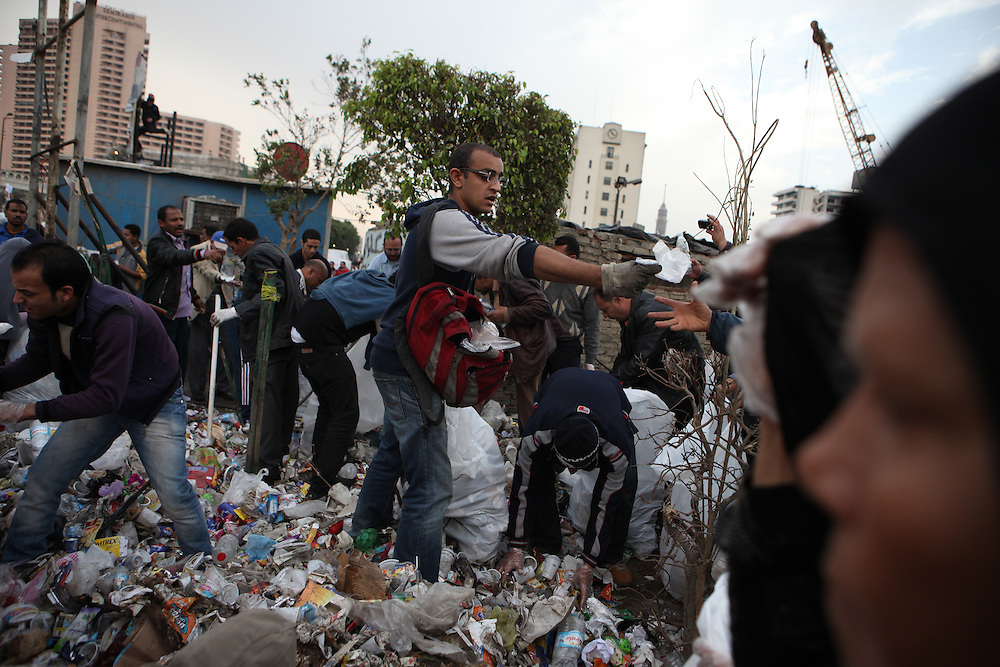 "On ""Sunday of the martyrs"" at Tahrir Square, protesters volunteer to collect trash at the square."