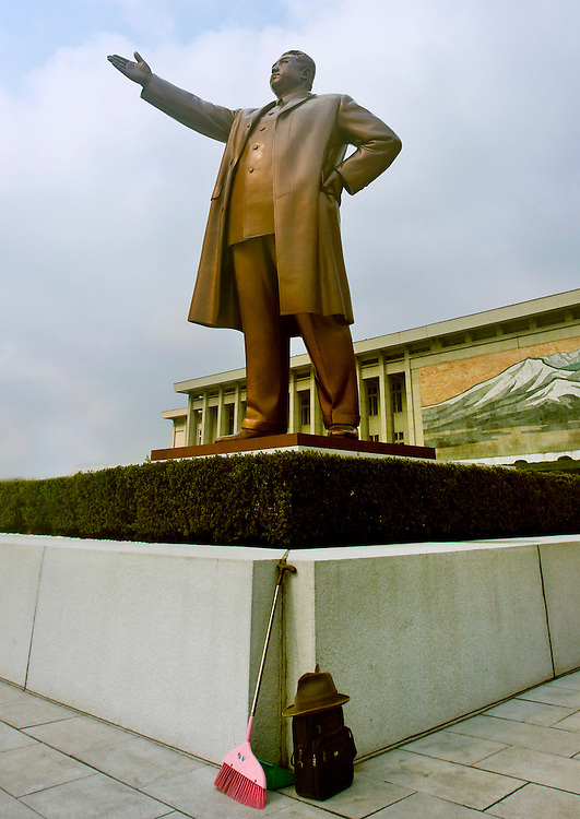North Korea, Pyongyang, Mansu Hill.<br /> <br /> This is never supposed to happen: a broom standing on the base of Kim Il Sung&rsquo;s statue in Mansudae, Pyongyang. Caption: Eric Lafforgue