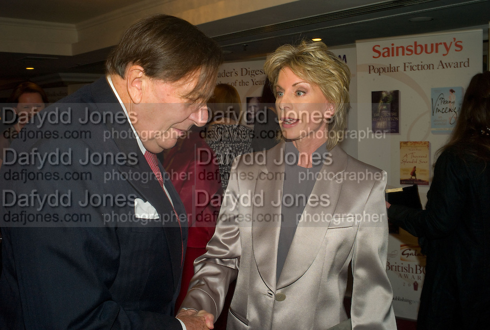 BARRY HUMPHRIES AND PATRICIA CORNWELL, The Galaxy British Book Awards hosted by Richard Madeley and Judy Finigan. Grosvenor House. Park Lane. London. 9 April 2008. *** Local Caption *** -DO NOT ARCHIVE-© Copyright Photograph by Dafydd Jones. 248 Clapham Rd. London SW9 0PZ. Tel 0207 820 0771. www.dafjones.com.