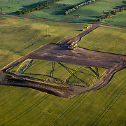 Land is in the process of being cleared for a new oil rig about to be installed on the North Dakota prairie outside of Williston, North Dakota. The oil boom is redrawing North Dakota's landscape and creating opportunity for thousands of unemployed Americans...Known for the beauty of its great plains, North Dakota has long been the least populated state in the country. Because of the Bakken oil boom,  everyday, mostly men, pour in from across the nation looking for work. The small town of Williston has exploded as a result. Ten years ago Williston, North Dakota was a quiet agricultural town with a population around 12,000..In a decade the population has more than doubled to over 30,000. More than half of Williston's residents now work in oil-related jobs and the city's unemployment rate is at 1 percent, which is the lowest in the U.S...