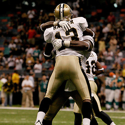 2009 September 03: New Orleans Saints wide receiver Rod Harper (13) celebrates with teammate Anthony Hargrove after scoring on a punt return during a preseason game between the Miami Dolphins and the New Orleans Saints at the Louisiana Superdome in New Orleans, Louisiana.