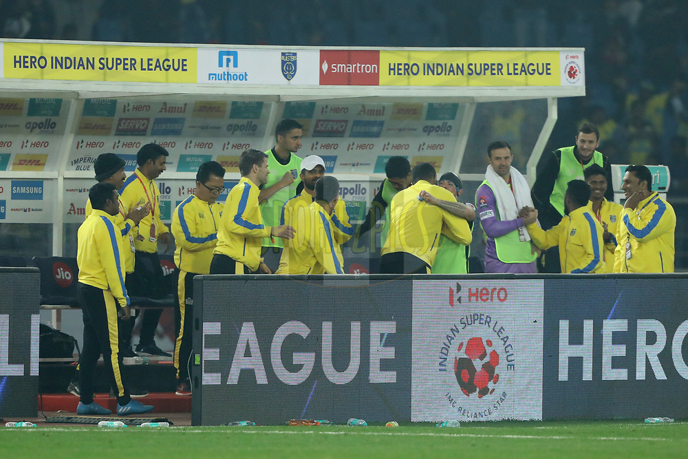 Iain Hume of Kerala Blasters FC  hugs to David James Head coach of Kerala Blasters FC after scoring goal during match 43 of the Hero Indian Super League between Delhi Dynamos FC and Kerala Blasters FC  held at the Jawaharlal Nehru Stadium, Delhi, India on the 10th January 2018<br /> <br /> Photo by: Arjun Singh  / ISL / SPORTZPICS
