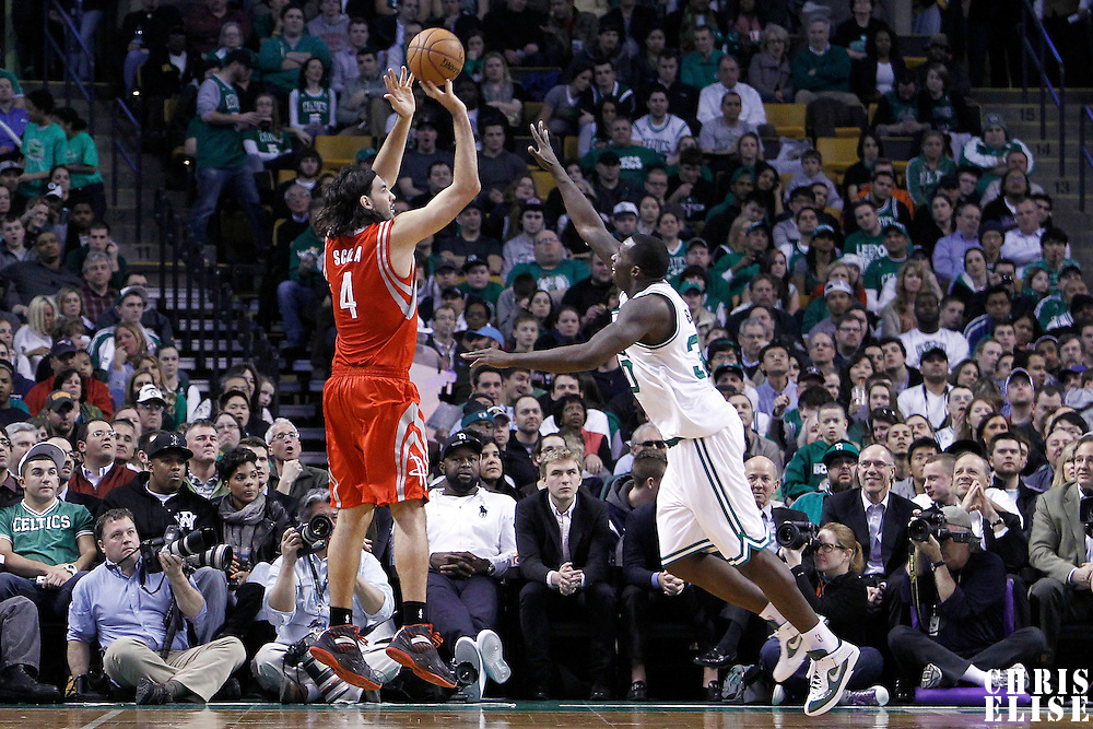 06 March 2012: Houston Rockets power forward Luis Scola (4) takes a jumpshot over Boston Celtics power forward Brandon Bass (30) during the Boston Celtics 97-92 (OT) victory over the Houston Rockets at the TD Garden, Boston, Massachusetts, USA.