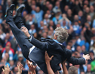 Manuel Pellegrini, manager of Manchester City celebrates winning the  Barclays Premier League at the Etihad Stadium, Manchester<br /> Picture by John Rainford/Focus Images Ltd +44 7506 538356<br /> 11/05/2014