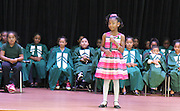 An Atherton Elementary School student performs during the school's dedication.