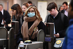 © Licensed to London News Pictures. 09/03/2020. London, UK. A commuter at Westminster Underground station in central London, wearing a medical mask. New cases of the COVID-19 strain of Coronavirus are being reported daily as the government outlines it's plans for controlling the outbreak. Photo credit: Ben Cawthra/LNP
