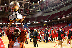"""PIAA District 12 Public League Basketball Championships Final, Liacouras Center, Philadelphia, PA, USA - February 24, 2013; Christine """"Mama Chris"""" Wiggins, founder and CEO of Imhotep Institute Charter High School, shows of the trophy to fans in the seats."""